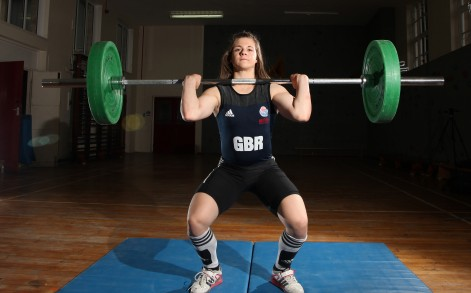 The mighty teenager can heave a colossal 123kg over her head.