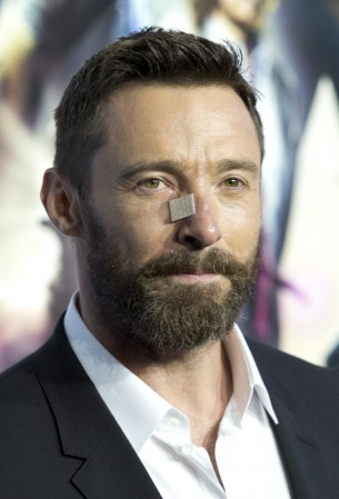 Despite the plaster on his nose, Jackman still manages to scrub up well