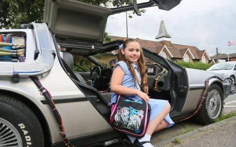 Proud: Molly loves her father's car and hopes to learn to drive in it.