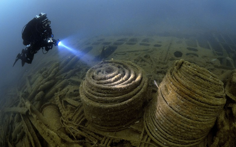 The underwater wrecks, which date back to WW1 and WW2, are buried deep beneath the sea