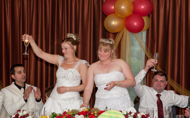 A toast to the happy couples: The group enjoying their big day