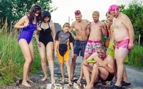 A group of bathers pose for a photo mocking the pothole situation in Lithuania.