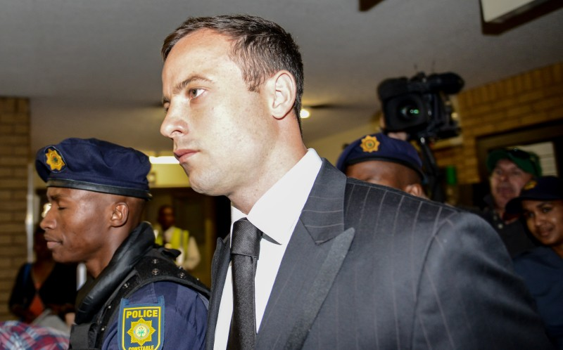 outh African paralympian Oscar Pistorius, who was found guilty of capable homicide for causing the death of his girlfriend Reeva Steenkamp, enters the High Court to be delivered his fate