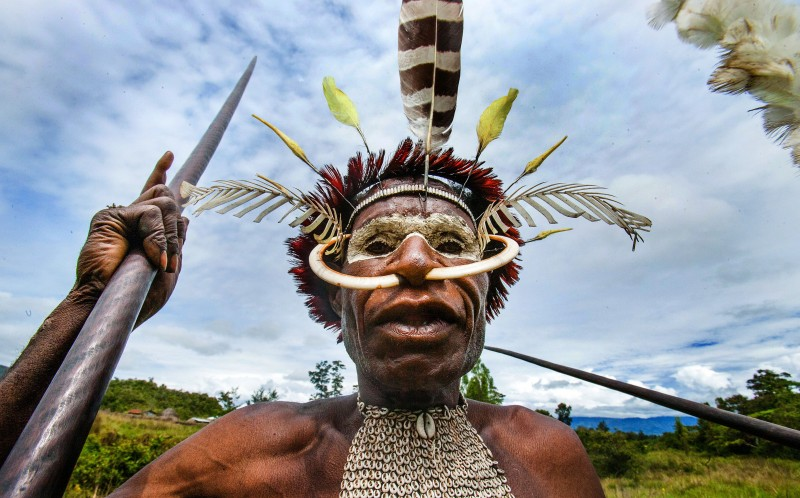 Captured wearing elaborate head dresses, then tribes-people have very limited contact with the outside world