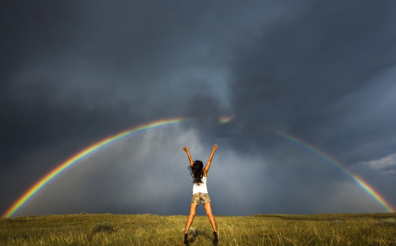 Jump Bow- Daow jumping infront of the rainbow and stormy sky