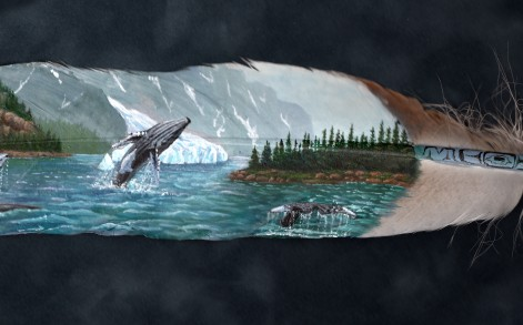 A whale leaps out of the water in one of Julie's designs.