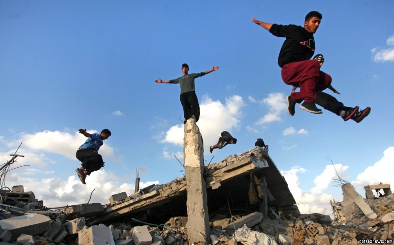 Daredevil teens do parkour just metres away from exploding bombs on the Gaza strip