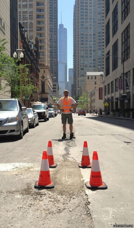 Disguised as a utility worker the artist is trying to rid Chicago's streets of the public nuisance for good