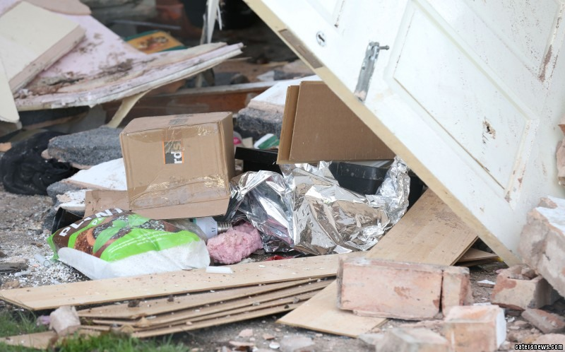 """Tony Rice, 50, who lives opposite, said: """"I heard this massive boom and when I went outside a front door frame had smashed my van window."""""""