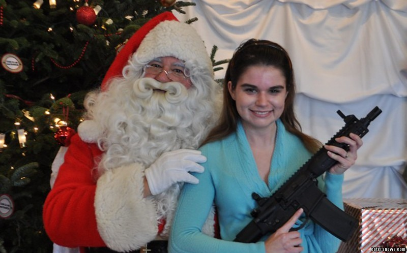 Children have the chance to be snapped with an AK-47, AR-15 and FN-SCAR-17