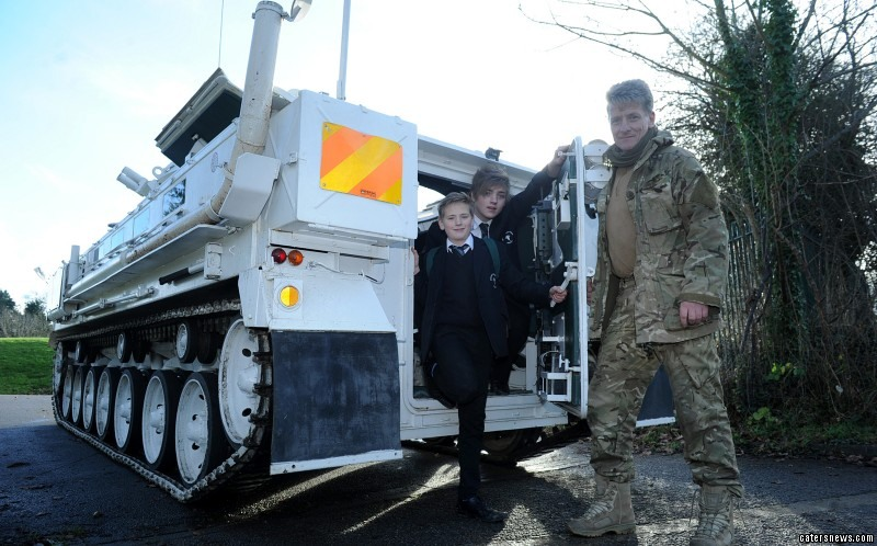 Kids go to school in TANK