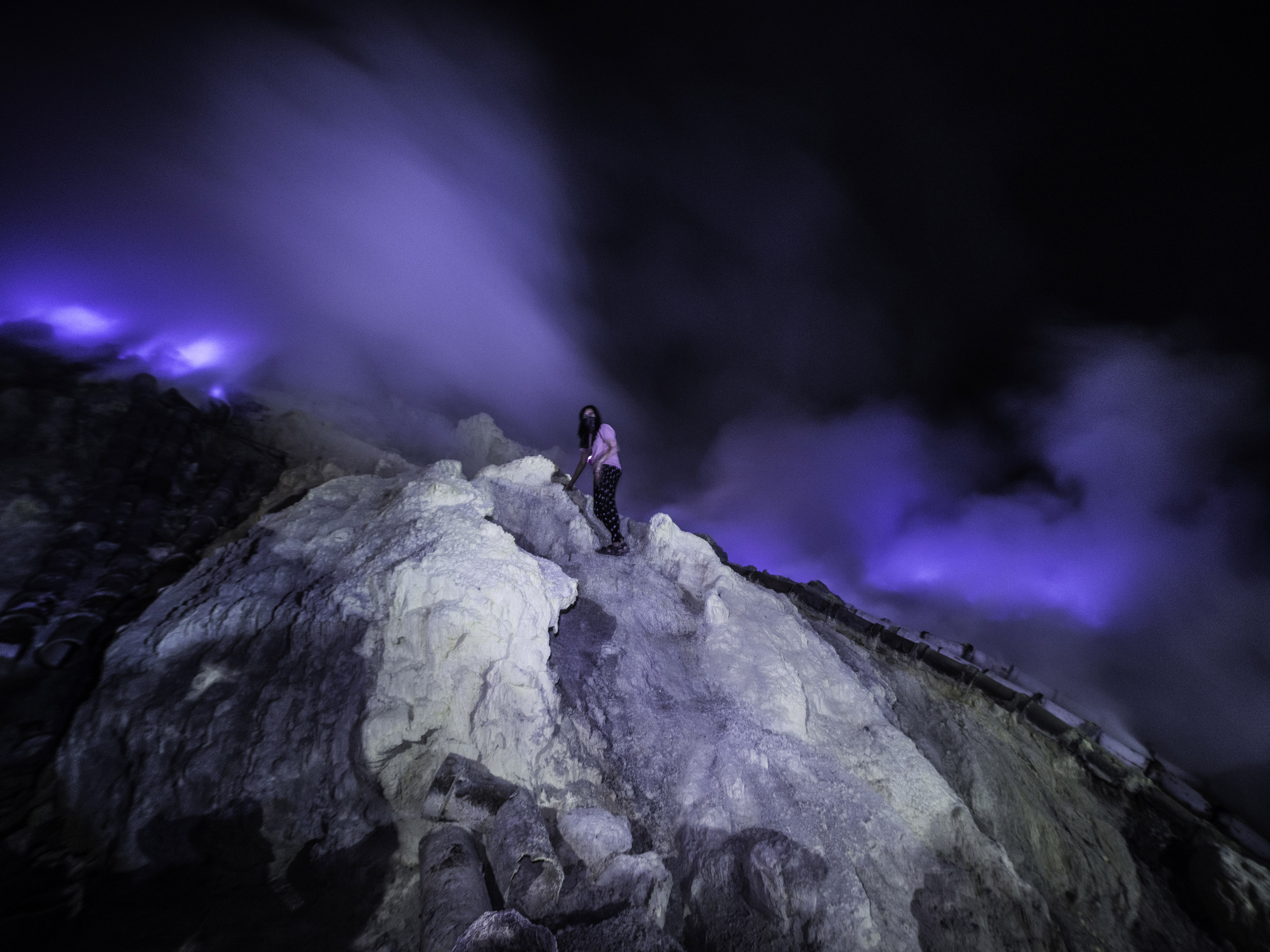 brave photographer scales volcano and battles fumes to