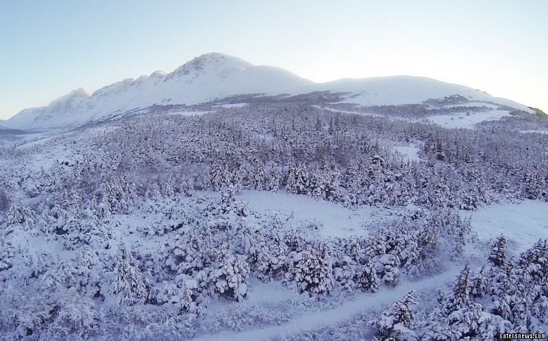 The aerial footage captures the untouched beauty of the Alaskan wilderness
