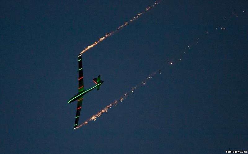 lThe world champion glider it up the sky with a pyrotechnics-packed display in his hometown