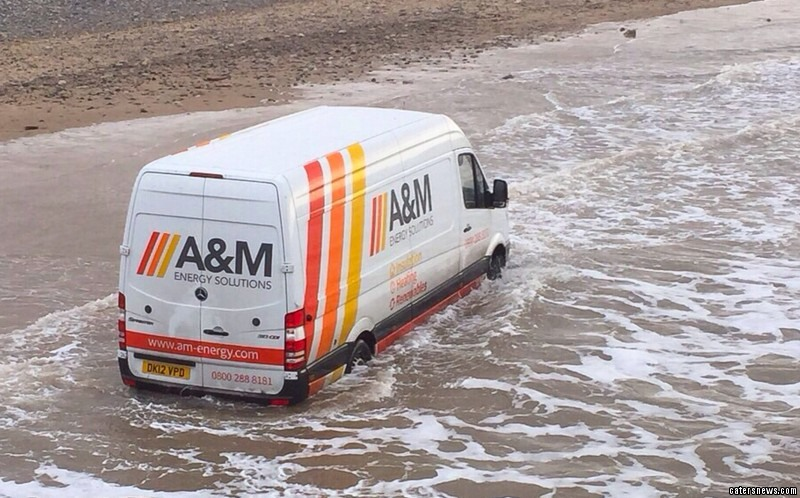 The van driver became marooned in the sand after going down a slipway.