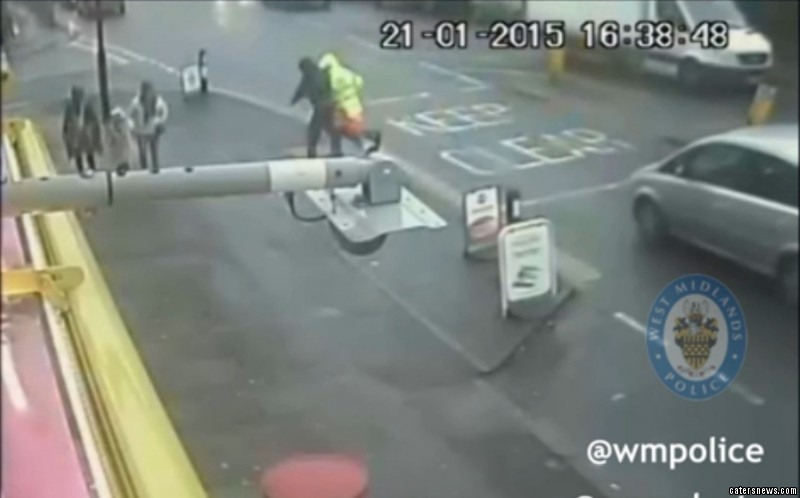 The shocking footage shows a defenceless lollipop man have his sign stolen