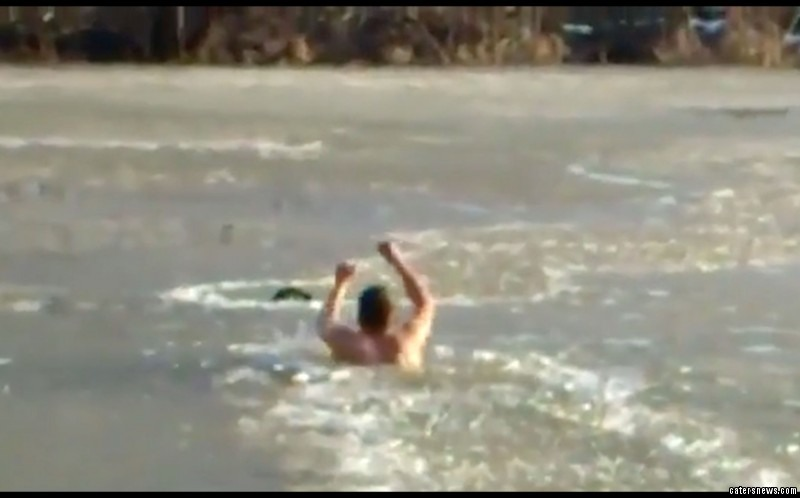 The man can be seen smashing through the ice with his bare hands