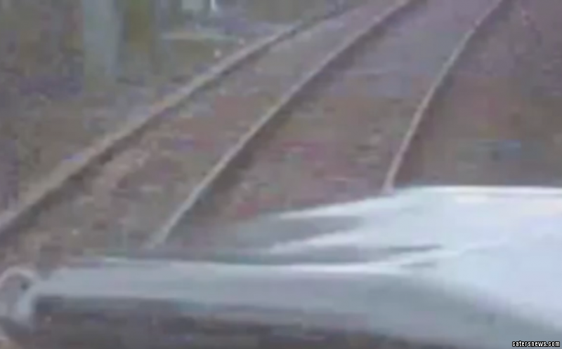The train comes within inches of hitting the land rover