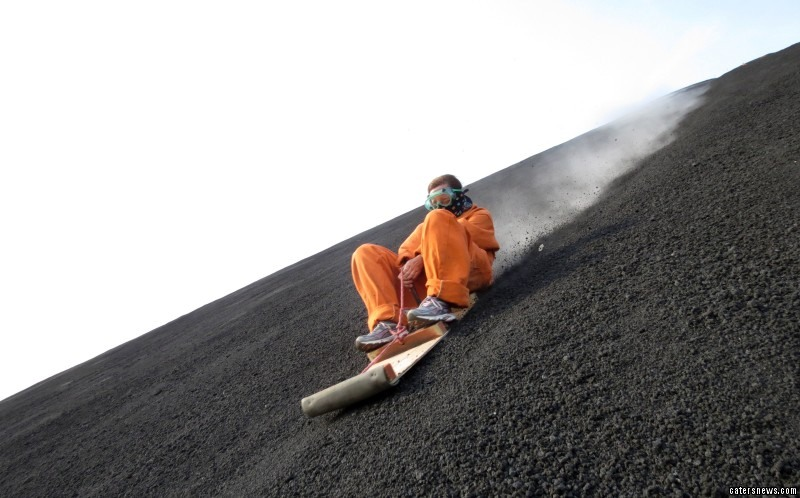 Thrill seekers hike to the top of the volcano before making their exhilarating 500m descent to the bottom