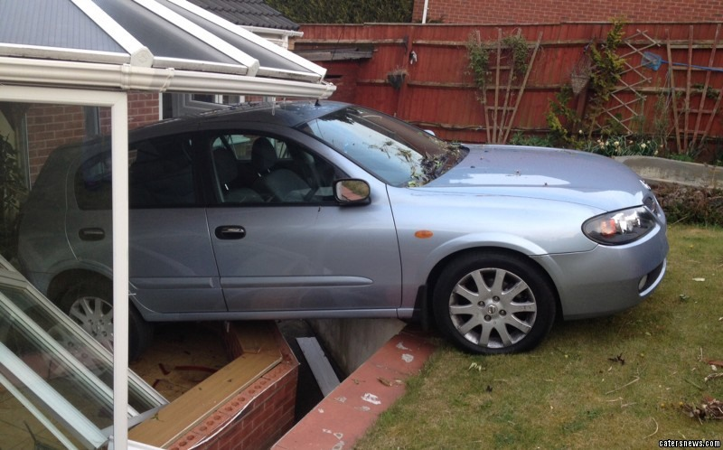 A silver Toyota plowed through her conservatory doors