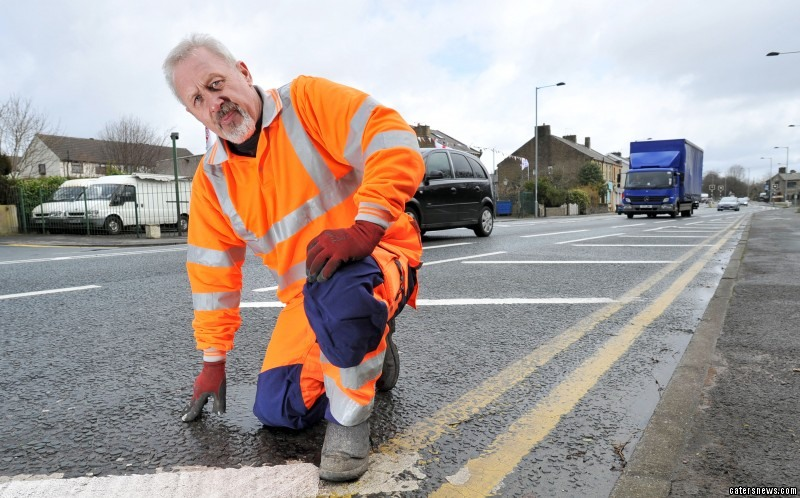 Andy Wilks has travelled the world three times painting double yellow lines