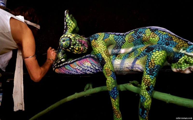 Beleive it or not, this piece, entitled 'The Chameleon', is actually two painted women