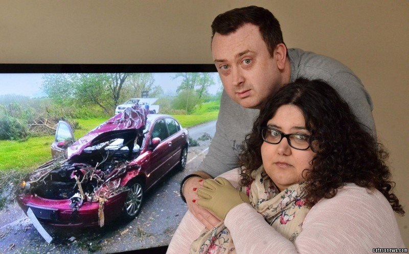 Kirran Jones and Gavin Davies escaped with just bruises after a 30 foot tall tree crushed their car