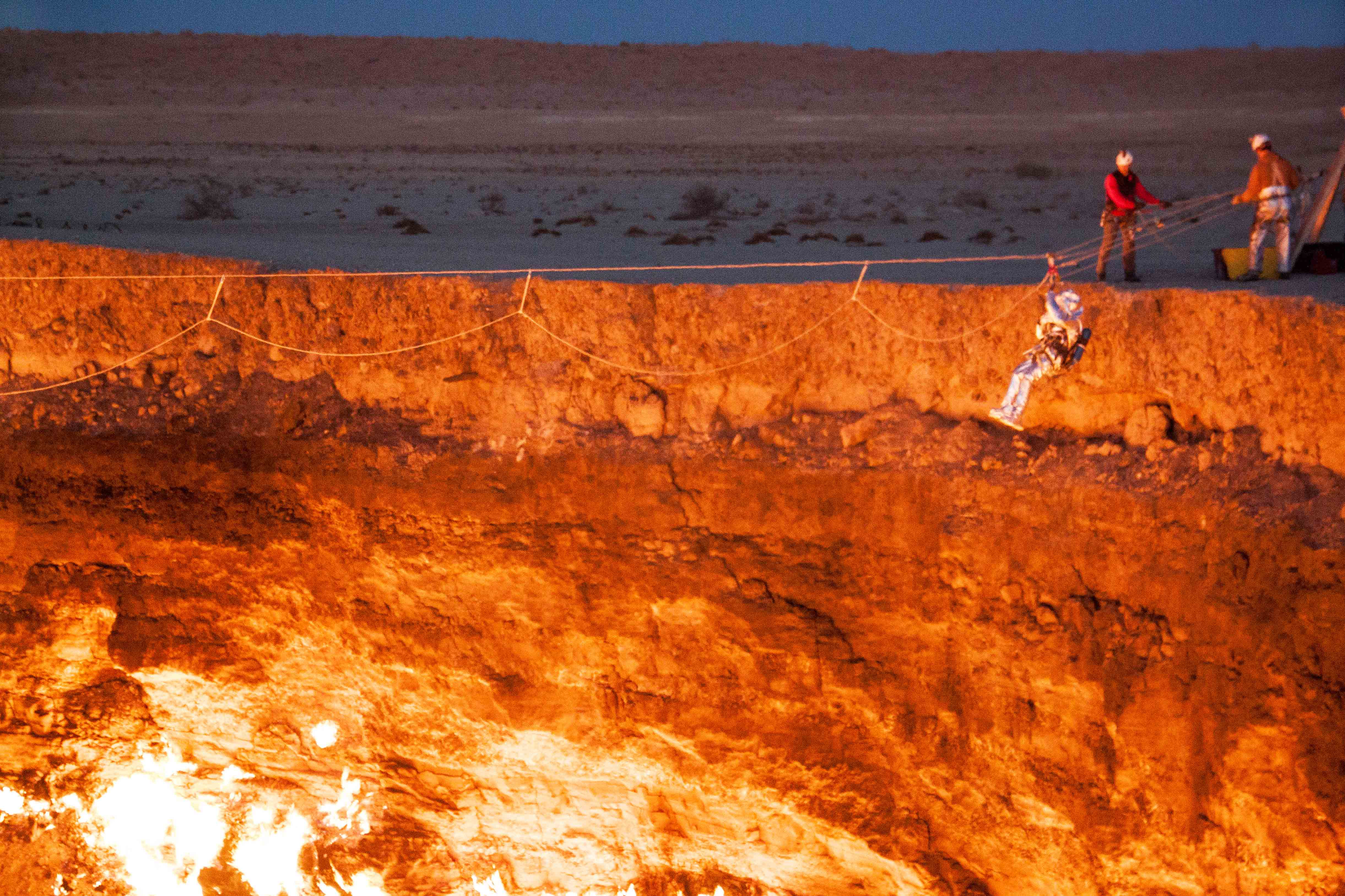 Explorer Sets Foot On Surface Of Crater Dubbed Door To Hell