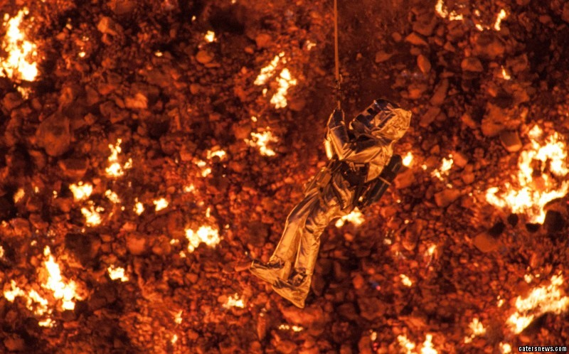 He braved temperatures in excess of 1,000C to rappel almost 100ft into the flame-filled crater