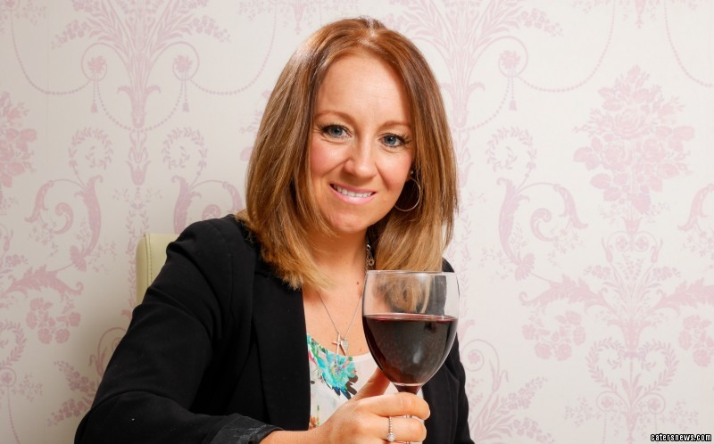 Leanne Arnold  with a glass of wine, celebrating being healthy again.