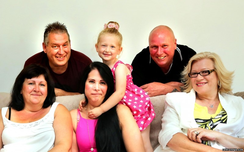 PIC FROM CATERS NEWS - PICTURED: (l to r BACK) Chris Woodward (55), Melvyn McHaffie (Dad, 54), (l to r FRONT) Joanna Woodward (Mum 52), Jannine & Leylah, (Stepmum) Karen McHaffie (58)) A beautiful mum has had parts of her face removed after severe nosebleeds which were misdiagnosed as hay fever turned out to be cancer. Pretty Jannine McHaffie, 25, from Wisbech, Cambridgeshire, had her upper teeth, pallet bone, top right jaw, and parts of her cheek bones removed after being diagnosed with adenoids cystic carcinoma. The brave full time mum was diagnosed with the rare cancer, which affects the salivary glands, six months after finding a strawberry sized tumour in her nose. Now Jannine is back home recovering after surgeons removed a bone from her leg to rebuild the missing facial features. SEE CATERS COPY.