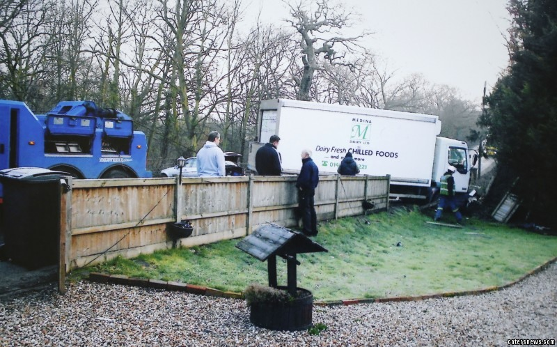 On 13 February 2013  6.00am, a lorry ploughed through garden fence