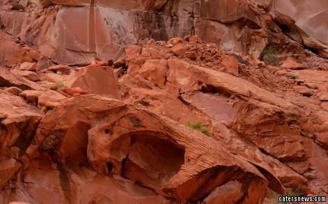 Painted into rocks using body paints and raw pigments in Valley of Fire, Nevada