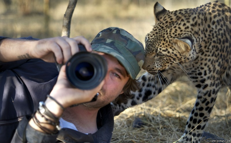 Russell and the leopard get close whilst he is in the Tshukudu Game Reserve in South Africa