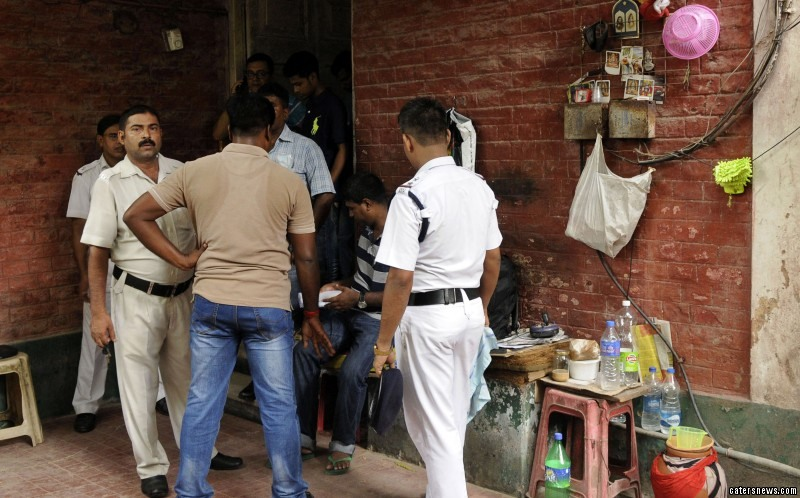 The policemen investigate at the house where Partha kept the skeletons