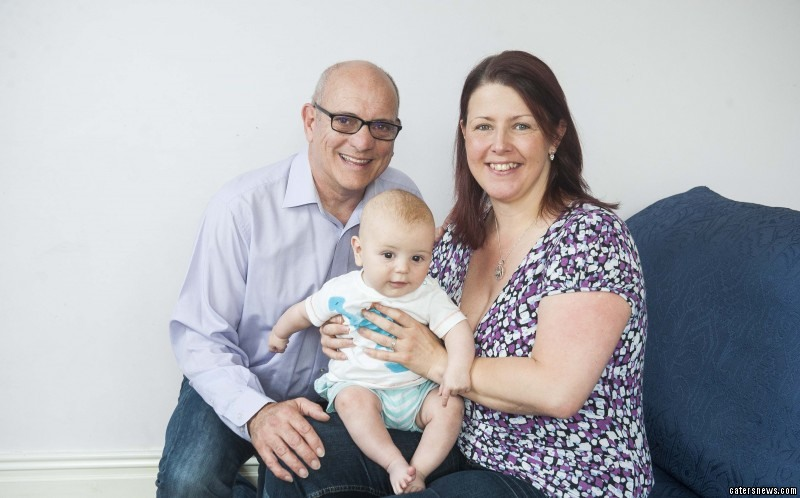 Colin Ward, 57, with his wife Kathryn Ward, 38, and their son Torin