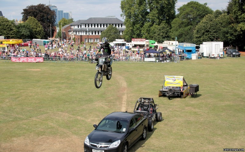 Aaron performs a jump over a car and a 4 wheel buggy