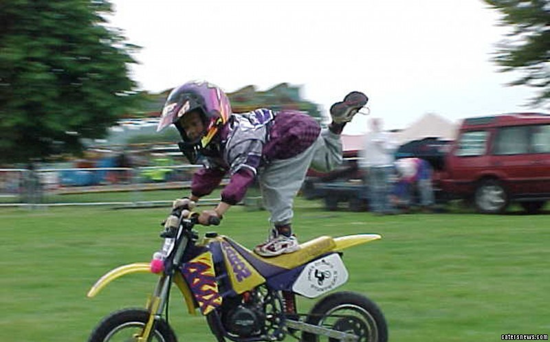 Aaron as a youngster performing stunts on his bike