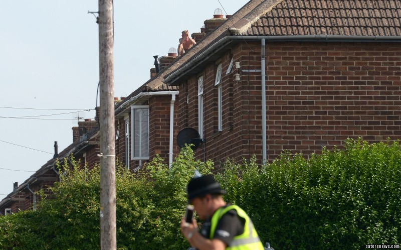 The 20-year-old – who has not been named – scaled the houses in Grimsby, Lincs, before stripping down to his black boxers
