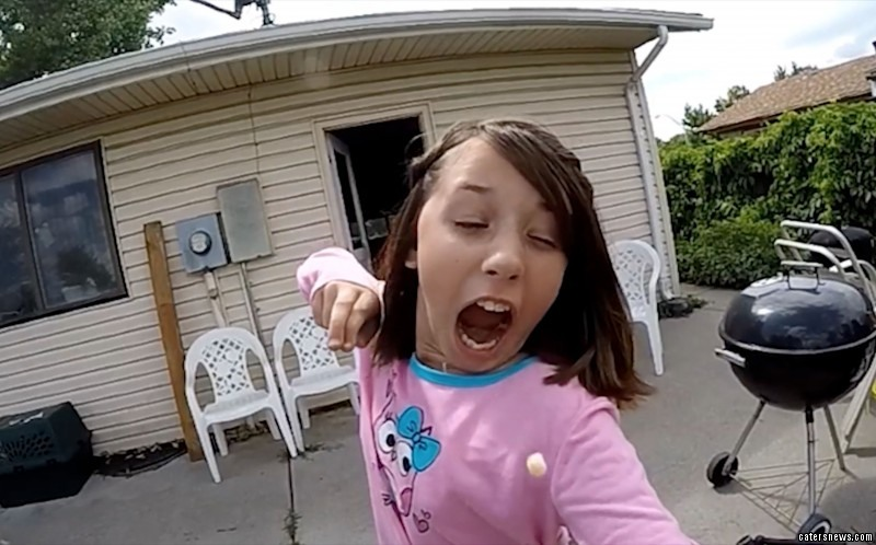 The video shows Alexis Davidson, 11 from Aurora Colorado firing the slingshot and pulling the tooth from her mouth