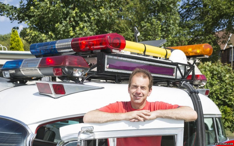 PIC FROM CATERS NEWS - (PICTURED: Paul posing with his car )