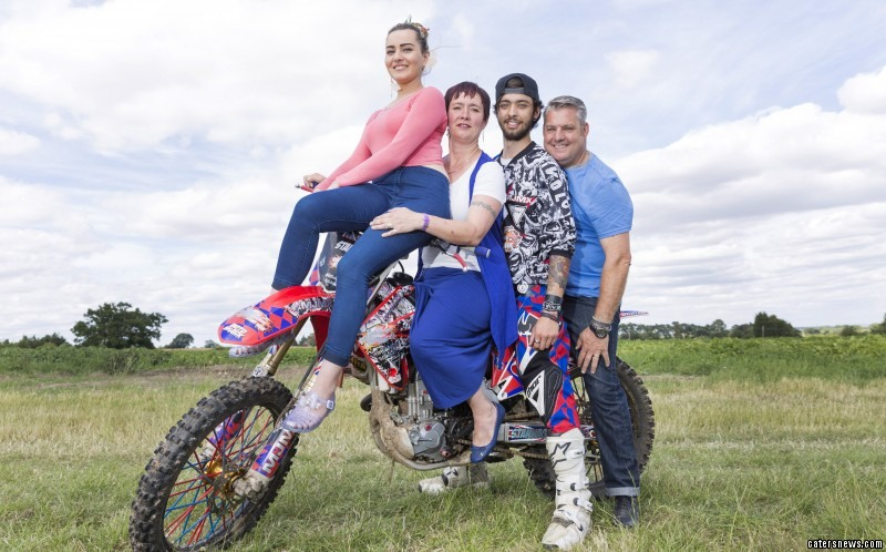 Megan Murphy, Janine Stannage, Aaron Stannage and Mark Stannage perched on a motorbike