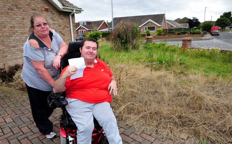 Dean Wingate, pictured with his personal assistant, Penny Hogan, in the garden of his home which a local resident has complained about in an anonymous letter