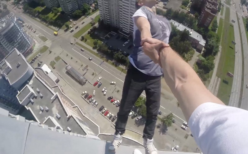 Ilya Bagaev hangs over the side of a building