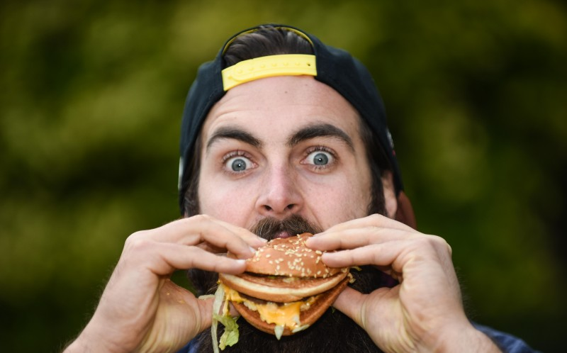 The burger lover has set a new world record - eating a belly-busting 17 Big Macs in under an hour