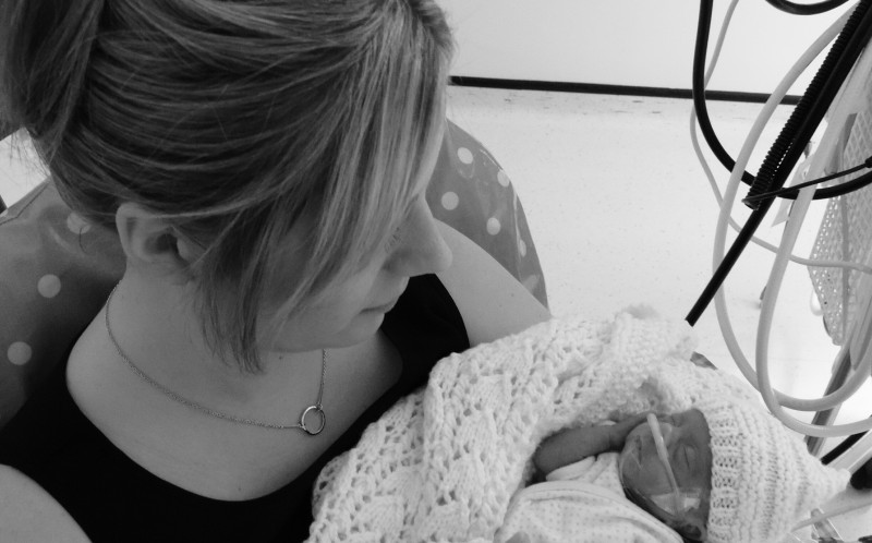 Mollie Perrin being held by Mum Stephanie in hospital