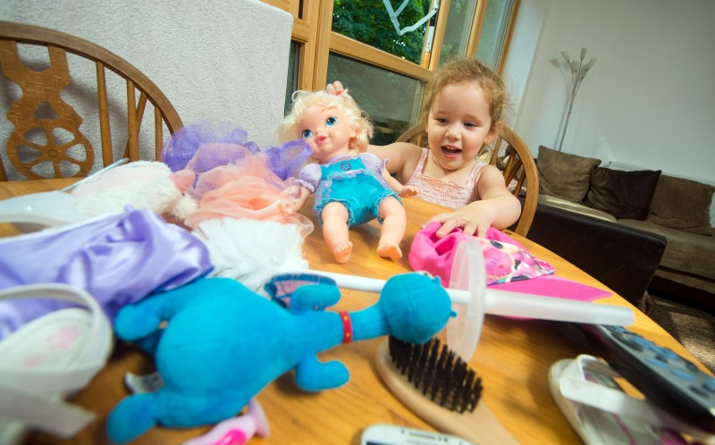 Lily Mullins who suffers from pica surrounded by all of the items she has tried to eat