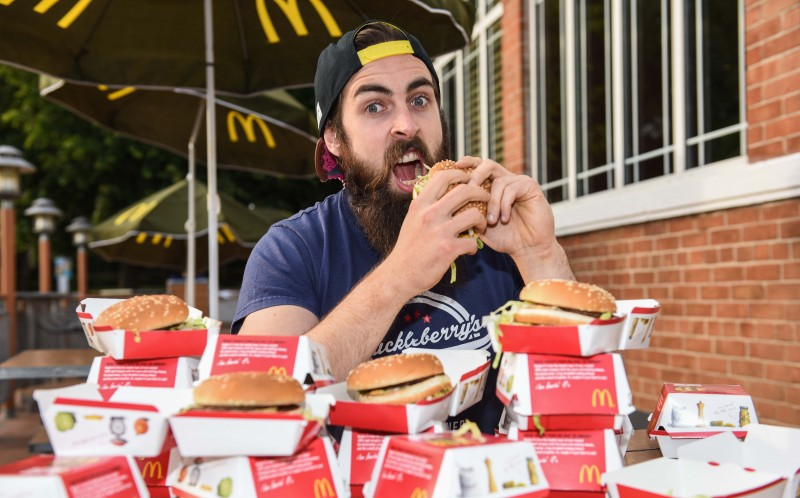 Adam Moran posed with 17 Big Macs, the world record amount