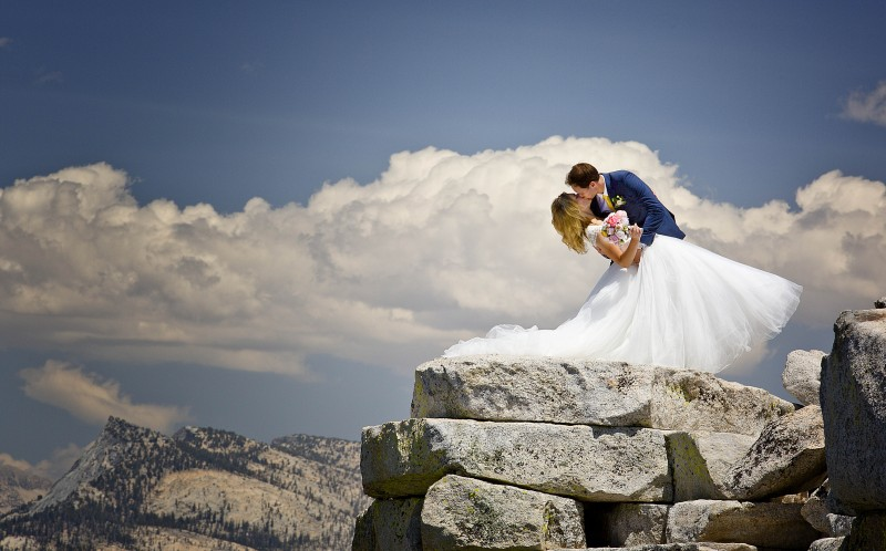 Brian Ruebs breath-taking shots show the bride and groom standing on top of the parks Half Dome