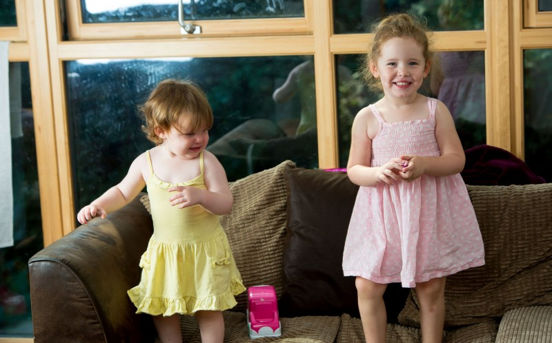 Lily (R) suffers from pica, which means she eats inanimate objects - including her sister Poppys dress (L).)